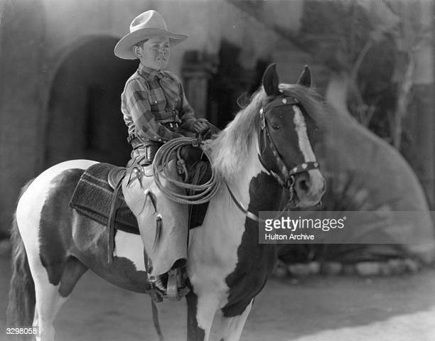 Buzz Barton the American character actor and child star who featured in many Westerns Viewed sitting on a horse wearing stetson and carrying a lasso