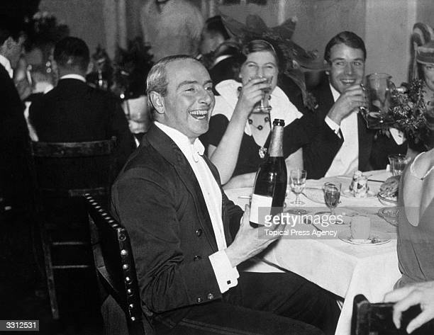 Guests at an RAF ball drinking champagne