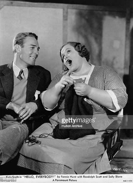Randolph Scott and Kate Smith enjoying a laugh during the production of 'Hello Everybody'