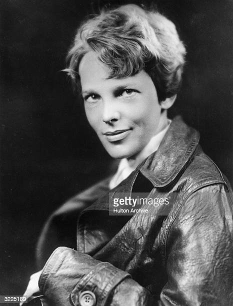 Studio headshot portrait of American aviator Amelia Earhart the first woman to complete a solo transatlantic flight wearing a leather jacket