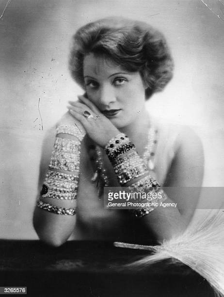 Marlene Dietrich the stage name of Maria Magdalena Von Losch the German singer and actress She is wearing ornamental bracelets on her arms