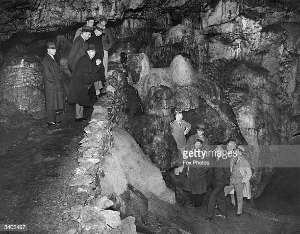 Members of the New Zealand cricket team looking at the Witch of Wookey a rock formation inside Wookey Hole Caves near Wells Somerset The team are in...