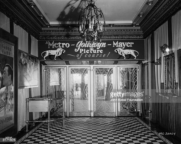 The glass doors of an MGM cinema emblazoned with the studio's lion logo and the words 'A MetroGoldwynMayer Picture of course'