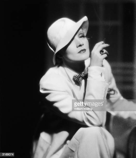 Film star Marlene Dietrich wearing a soft pullon hat and smoking a cigarette