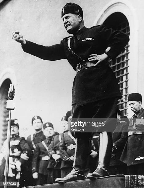 Italian fascist dictator Benito Mussolini shaking his fist during a speech