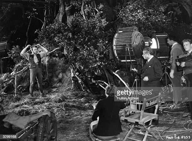Max Reinhardt formerly Max Goldman the Austrian theatrical producer is seen directing James Cagney the American leading actor and star in a scene...