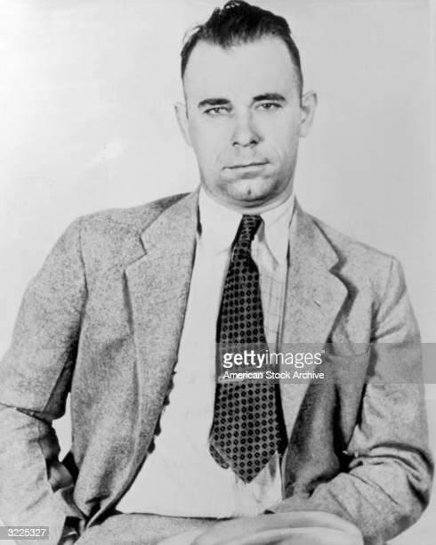 Portrait of American criminal gang leader and bank robber John Dillinger wearing a jacket and tie