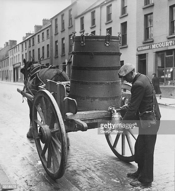 A buttermilk vendor with his horsedrawn cart in Derry City