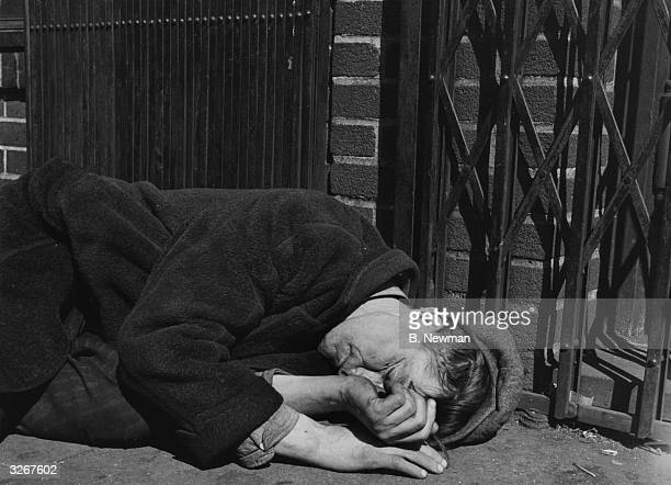 A downandout sleeps rough in the notorious Skid Row area a street in the Bowery New York City He knows enough to position himself on the west side of...