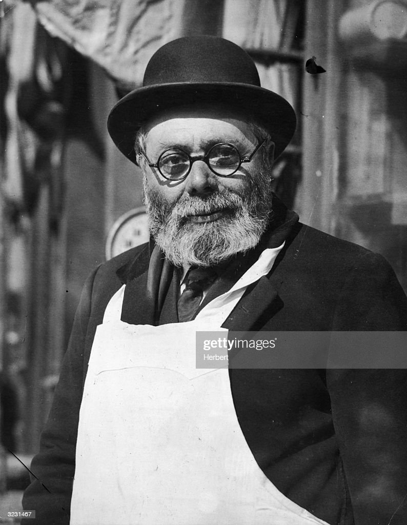 White apron and hat - A Middle Aged Bearded Man Wearing Horn Rimmed Glasses A Bowler Hat