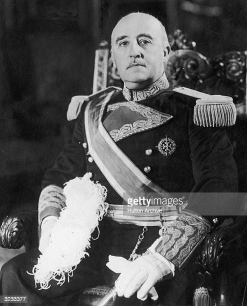 A portrait of Spanish dictator Francisco Franco sitting on a throne in full military regalia
