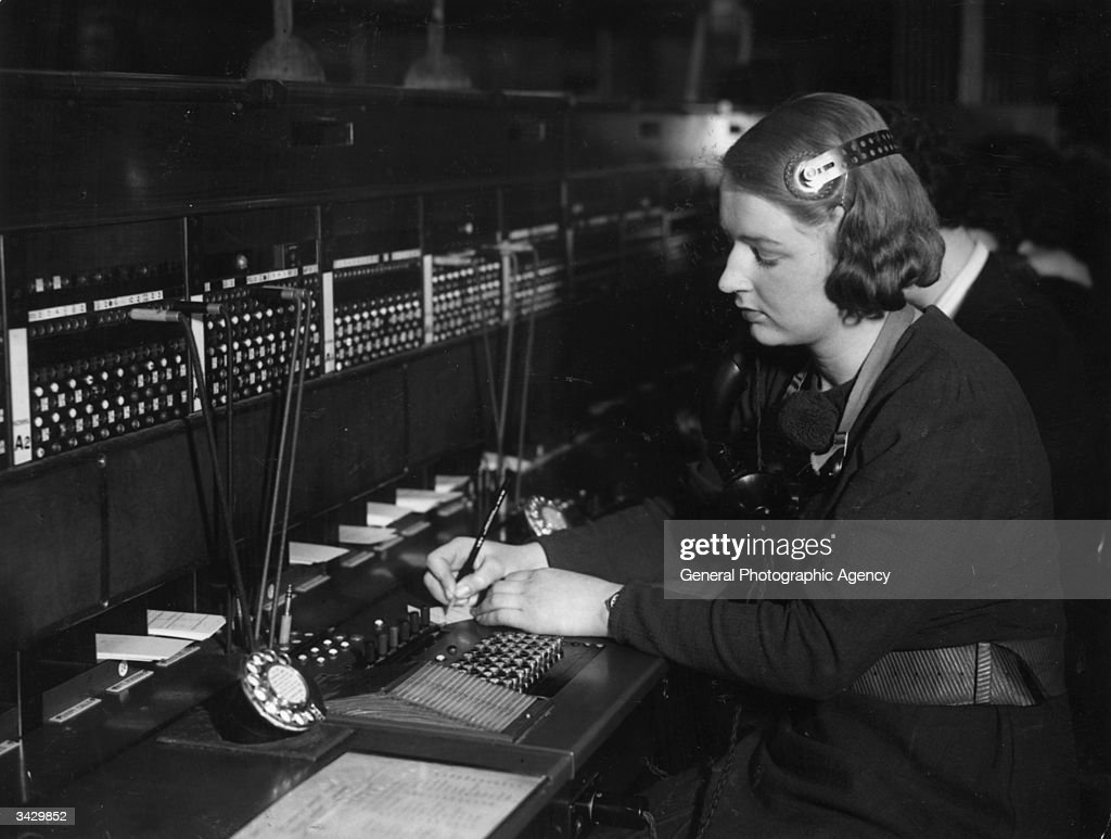 A woman at work on a switchboard.