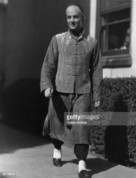 Actor Ramon Novarro with a shaved head is pictured between filming scenes for 'The Son Daughter'