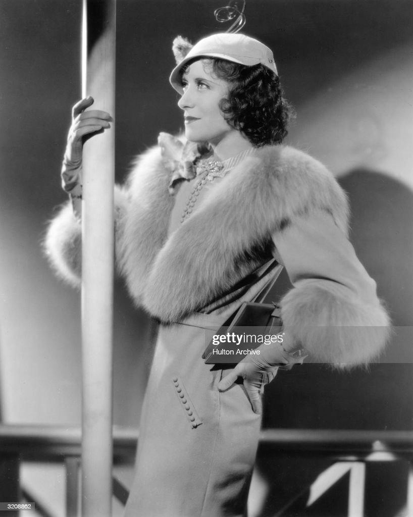American actor and comedian Gracie Allen wears an outfit made of gray wool and platinum fox as the bride in director Norman Z McLeod's film 'Many...