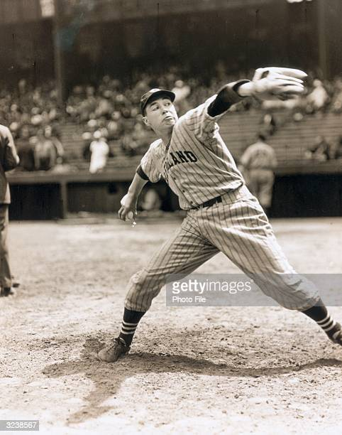 American baseball pitcher Bob Feller of the Cleveland Indians making a face as he winds up for a pitch