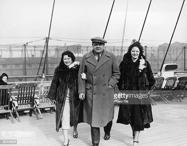 American baseball player George Herman 'Babe' Ruth walks with his wife Claire Merritt Hodgson and sister Julia on the deck of a ship