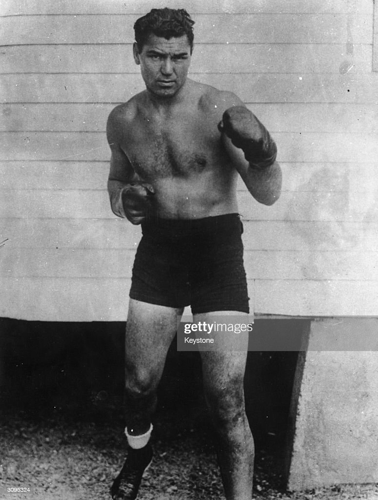 American heavyweight boxer <a gi-track='captionPersonalityLinkClicked' href=/galleries/search?phrase=Jack+Dempsey+-+Boxer&family=editorial&specificpeople=15348667 ng-click='$event.stopPropagation()'>Jack Dempsey</a> (1895 - 1983) strikes a sparring pose for the camera while wearing his boxing gloves.