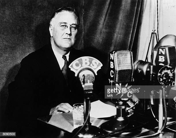 American politician and the 32nd President of the United States Franklin Delano Roosevelt delivering one of his fireside chats to the nation...