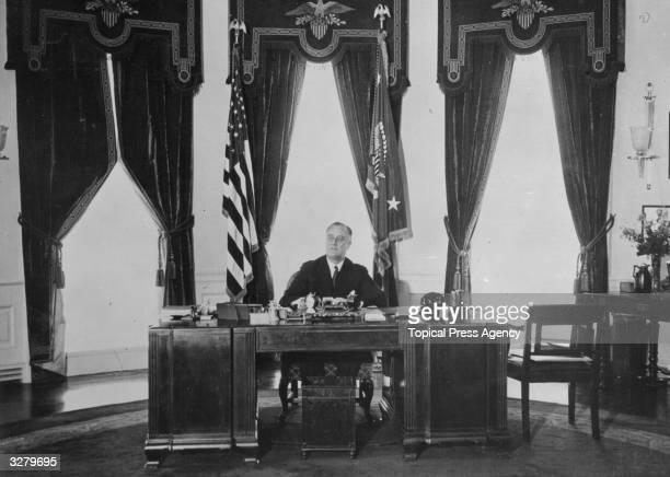 American President Franklin Delano Roosevelt sitting at his desk