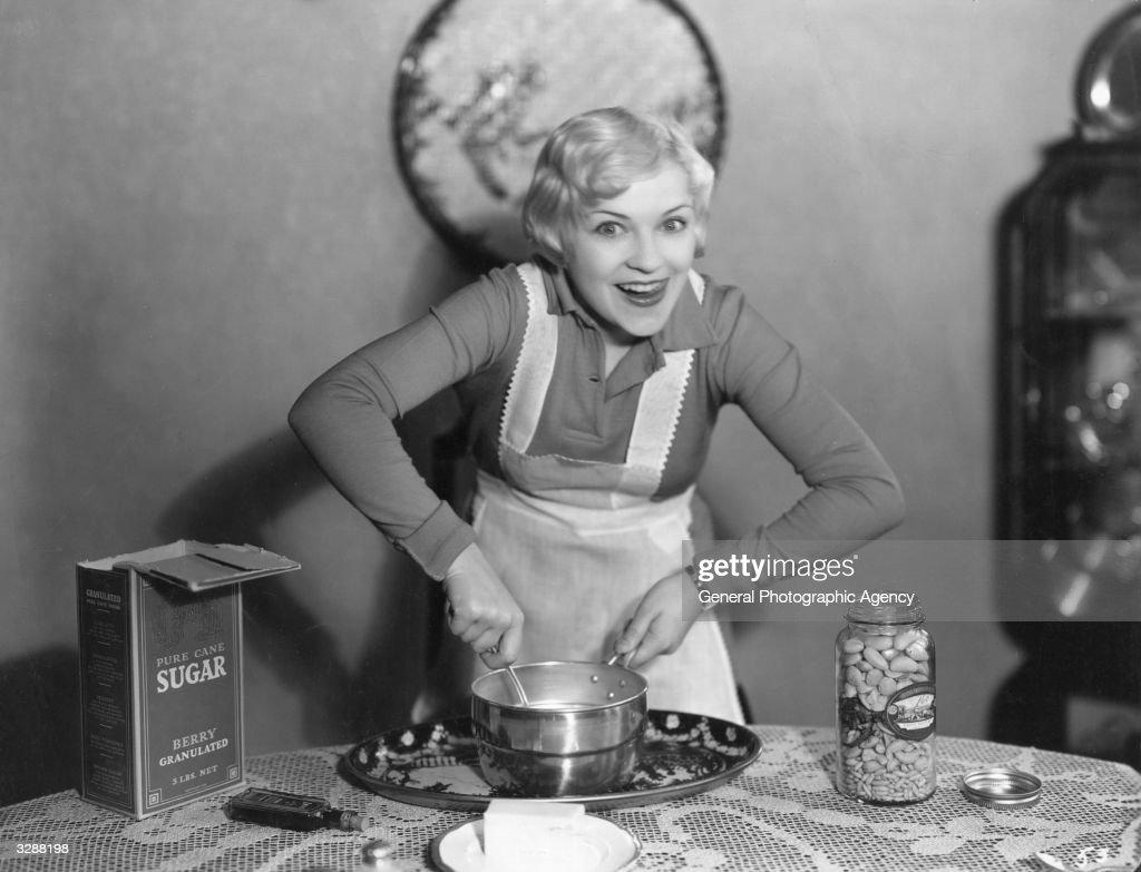An enthusiastic cook prepares a cake mixture.