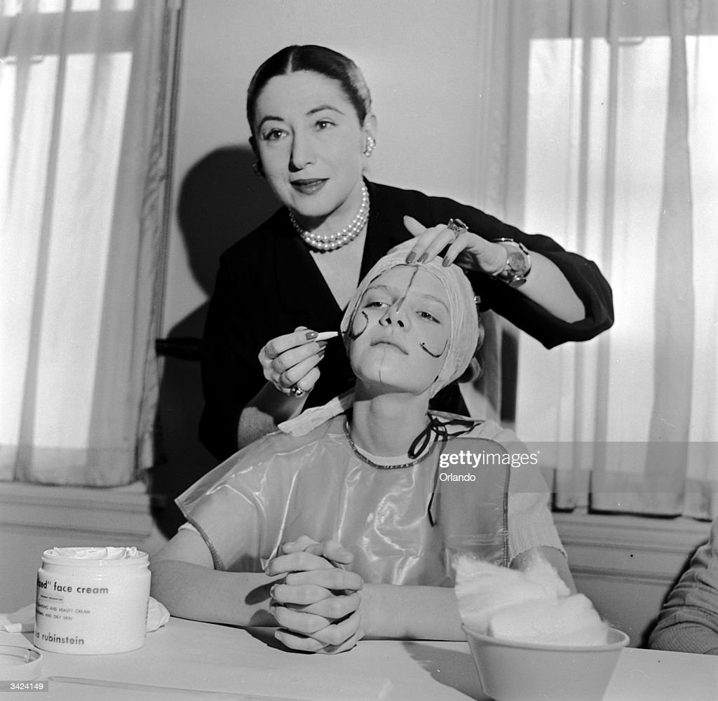 Beauty expert Helena Rubinstein illustrating the shape of the basic lines on the face so that makeup can be applied to flatter individual contours