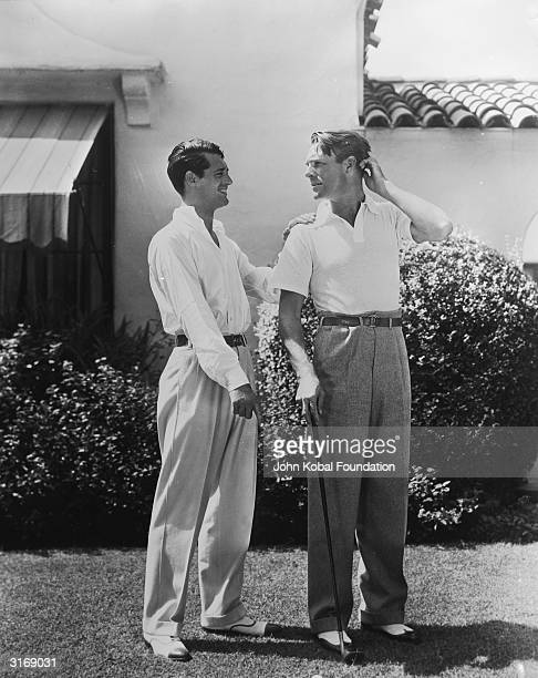 British born actor Cary Grant born Archibald Leach with the American actor Randolph Scott The two stars shared a beach house during the 1930's which...