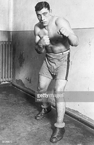 Fulllength portrait of Italianborn heavyweight boxer Primo Carnera posing barehanded in a fighting stance