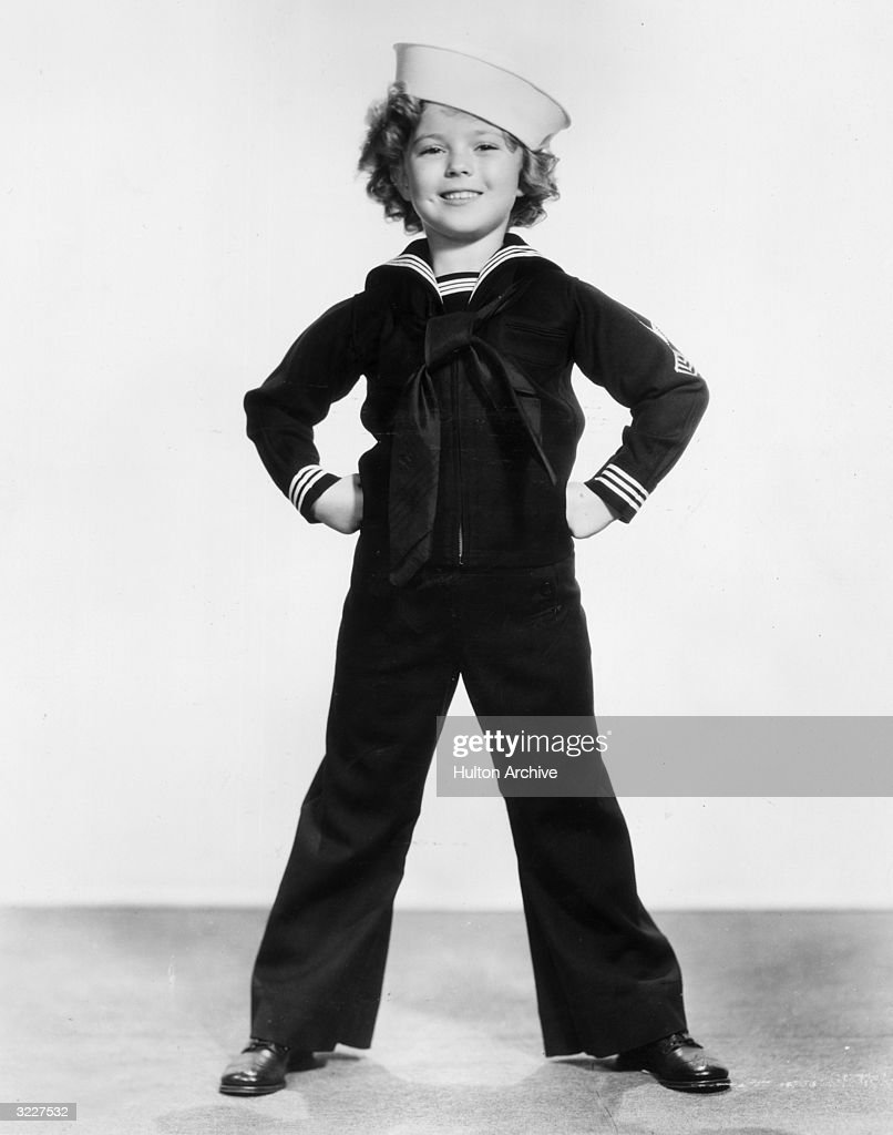 Full-length studio portrait of American child actor, dancer and singer <a gi-track='captionPersonalityLinkClicked' href=/galleries/search?phrase=Shirley+Temple&family=editorial&specificpeople=69996 ng-click='$event.stopPropagation()'>Shirley Temple</a> wearing a sailor's uniform and cap.