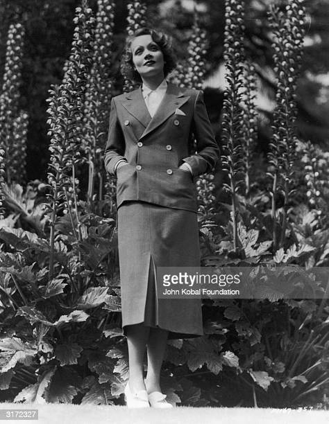 German born American actress Marlene Dietrich wearing a double breasted suit