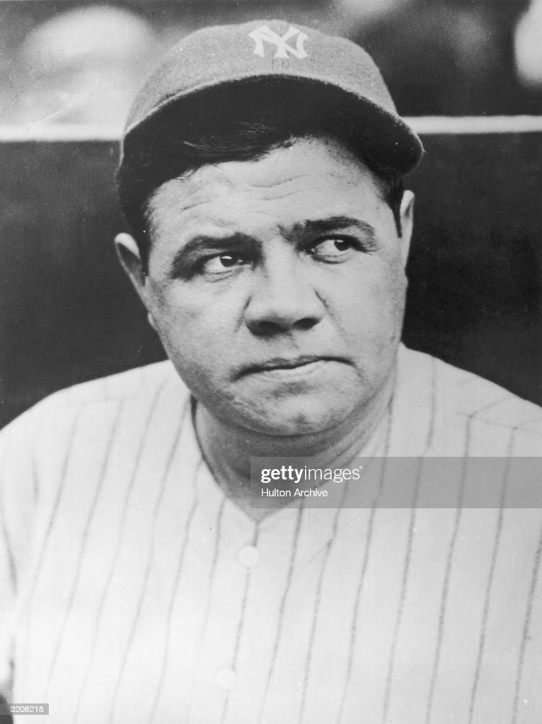 Headshot of American baseball player Babe Ruth wearing his New York Yankees uniform and cap