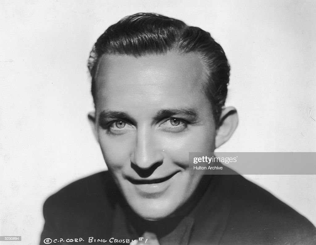Headshot portrait of American singer and actor <a gi-track='captionPersonalityLinkClicked' href=/galleries/search?phrase=Bing+Crosby&family=editorial&specificpeople=90412 ng-click='$event.stopPropagation()'>Bing Crosby</a> (1904 - 1977) smiling.