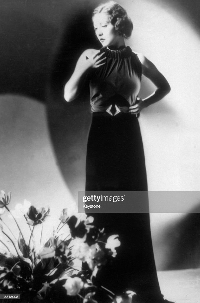 Hungarian actress Steffi Duna (1913 - 1992) wearing a bright scarlet velvet evening dress at a show in Hollywood.