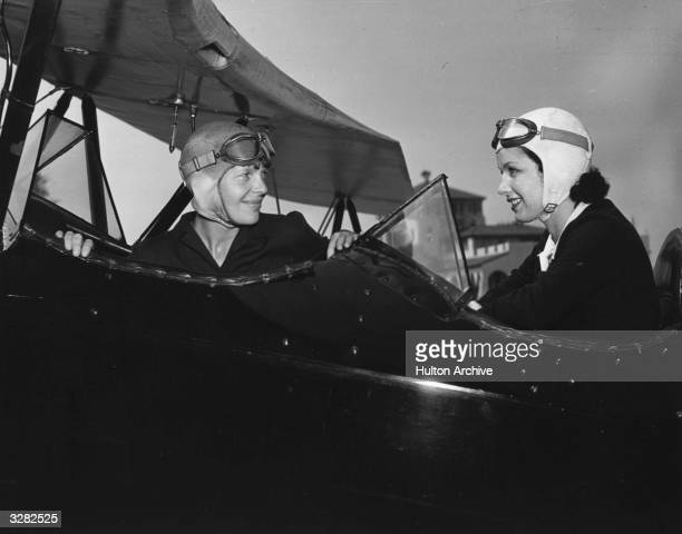 June Travis the Warner Brothers starlet taking flying lessons for her film 'Ceiling Zero' from Amelia Earhart the American airwoman from Kansas who...