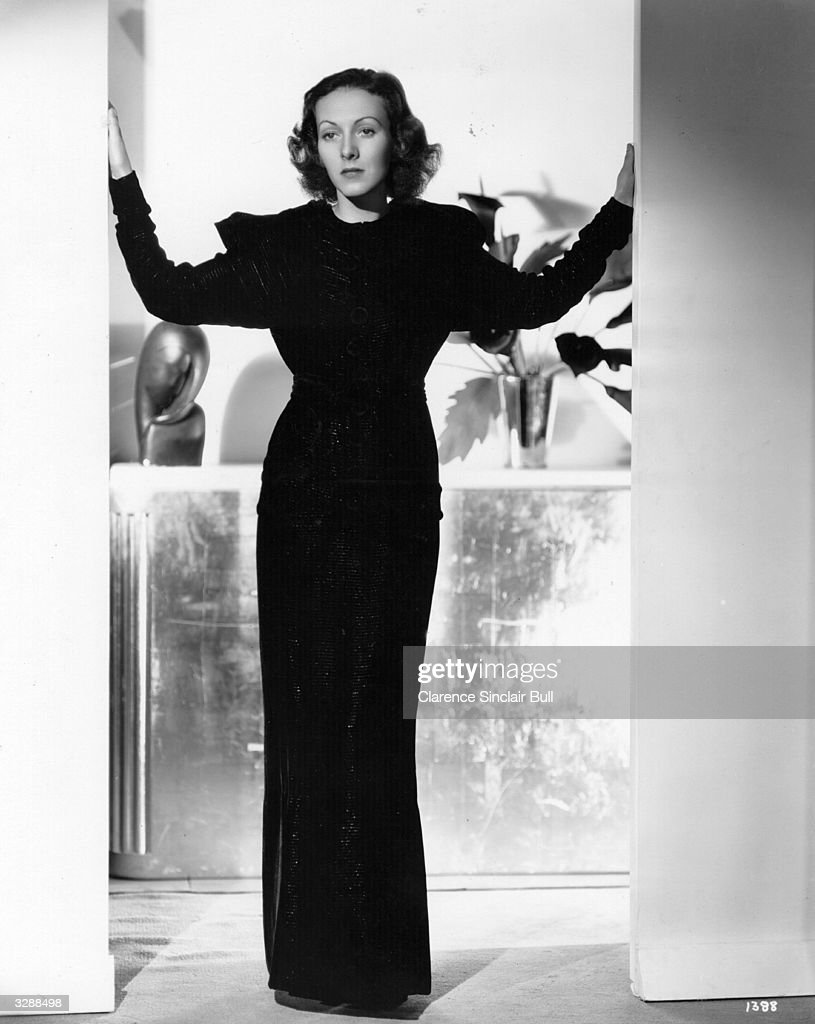 Karen Morley, stage name of Mildred Linton. The American actress is modelling a cocktail suit in gold threaded velvet designed and made by Phiffer's Incorporated.