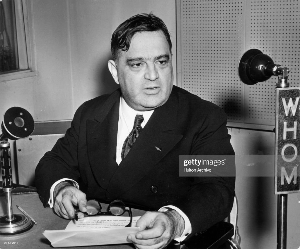 New York City mayor Fiorello Henry La Guardia (1882 - 1947) sits in the studios of WHOM radio, delivering an address, in Italian, to the people of New York. During the New York newspaper strike, La Guardia read the Sunday newspaper comics to the public each week.