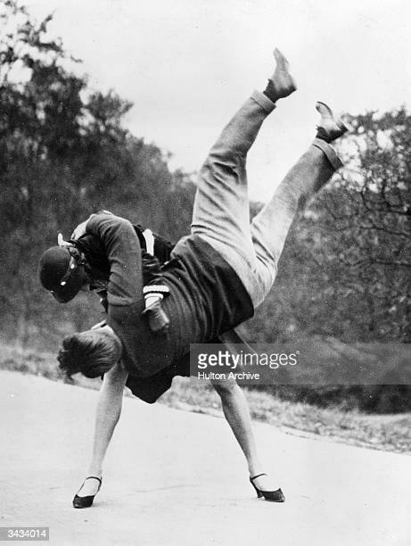 Phyllis Boutell a JuJitsu expert demonstrates how to get rid of a bag snatcher by means of a hip throw