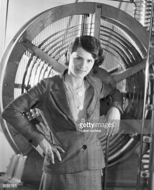 Portrait of American photographer Margaret BourkeWhite posing with equipment she used for a mural at Radio City Music Hall New York City