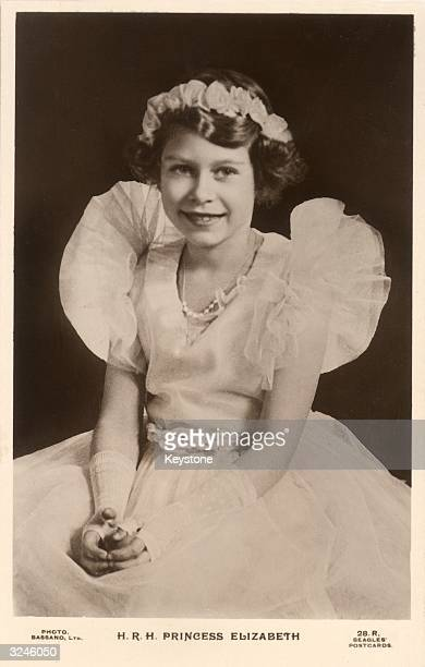 Princess Elizabeth later Queen Elizabeth II wearing lace fingerless gloves with a ruched chiffon dress