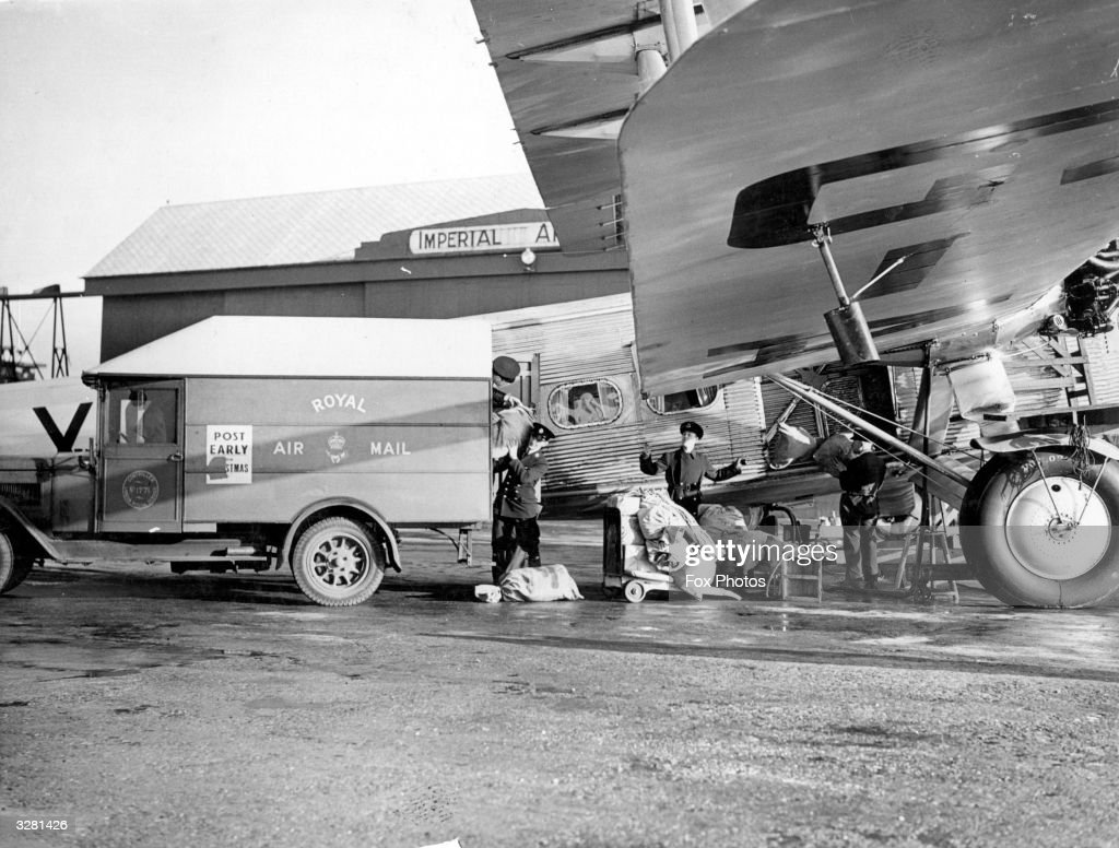 Royal Mail workers load sacks of post onto an Imperial Airways plane.