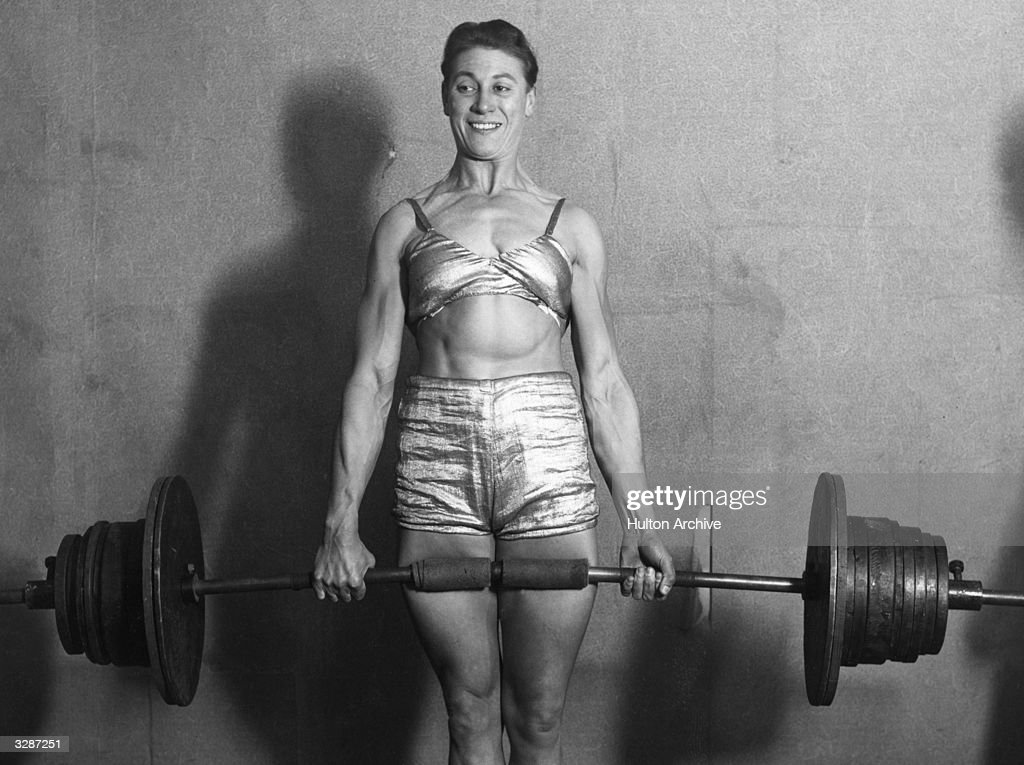 Strong-woman Ivy Russell lifting weights.