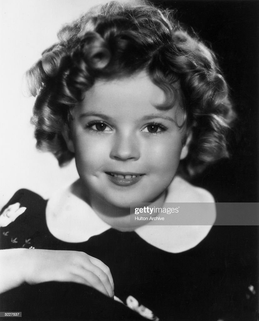 Studio headshot portrait of American child actor, dancer and singer <a gi-track='captionPersonalityLinkClicked' href=/galleries/search?phrase=Shirley+Temple&family=editorial&specificpeople=69996 ng-click='$event.stopPropagation()'>Shirley Temple</a> smiling.