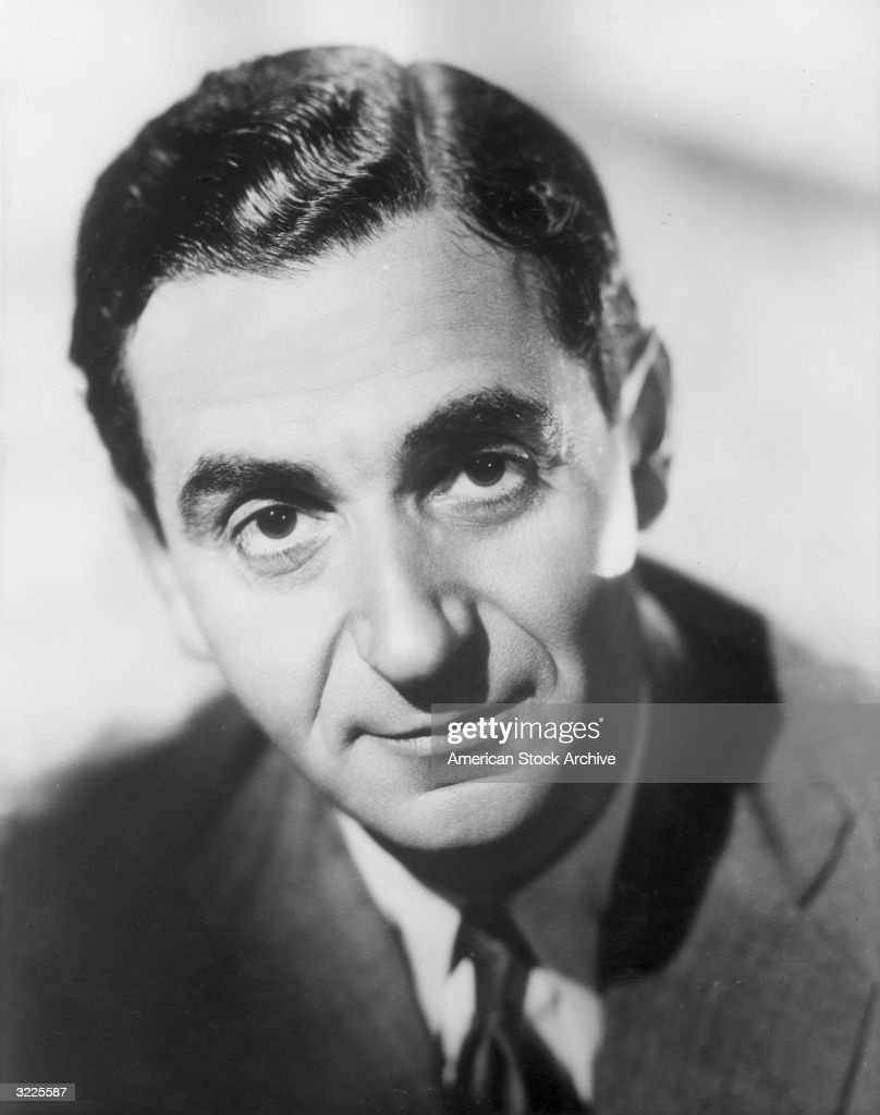Studio headshot portrait of American composer <a gi-track='captionPersonalityLinkClicked' href=/galleries/search?phrase=Irving+Berlin&family=editorial&specificpeople=208654 ng-click='$event.stopPropagation()'>Irving Berlin</a> (Israel Baline, 1888 - 1989) wearing a jacket and tie.