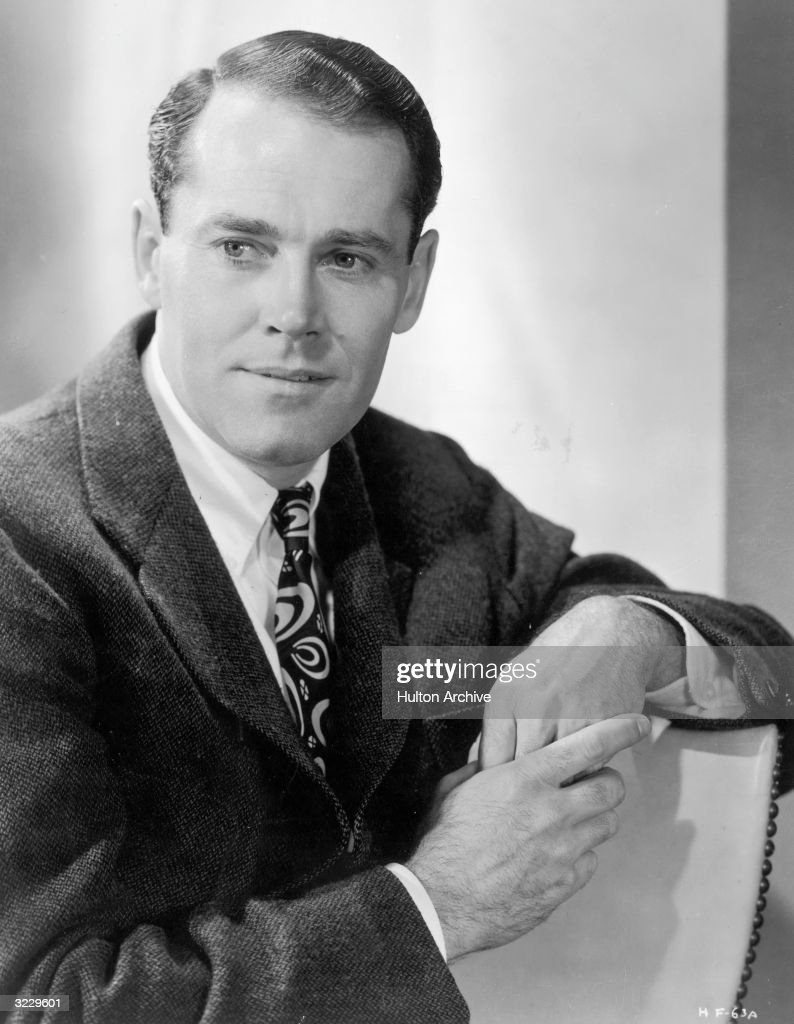 Studio portrait of American actor <a gi-track='captionPersonalityLinkClicked' href=/galleries/search?phrase=Henry+Fonda&family=editorial&specificpeople=93512 ng-click='$event.stopPropagation()'>Henry Fonda</a> smiling while leaning against the back of his chair.