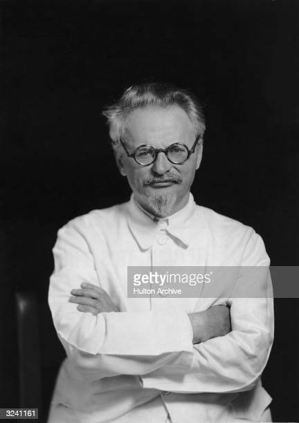 Studio portrait of Russian Communist leader Leon Trotsky wearing eyeglasses and a white jacket