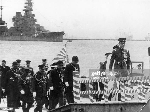 The former Emperor Henry Pu Yi of China with Japanese personnel probably during his reign of the Japanese puppet state of Manchuria
