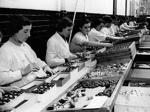 Workers in a Bedford factory placing chocolates in boxes