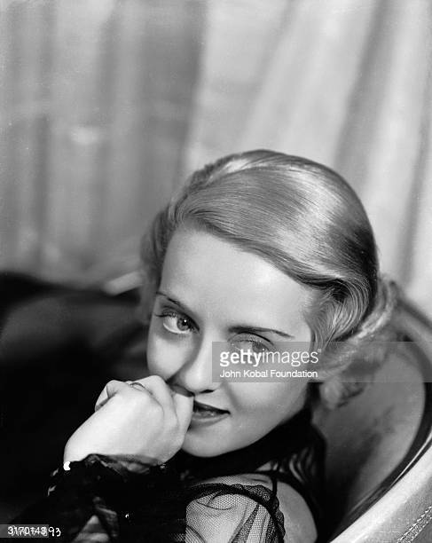 American actress Bette Davis who was born in Lowell Massachusetts and studied at John Murray Anderson's Dramatic School before being signed to...