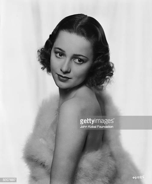 Britishborn actress Olivia de Havilland covers her modesty with a fur wrap