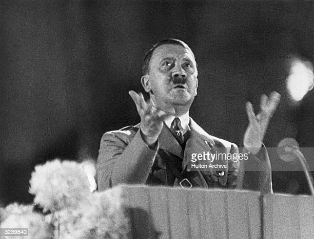 German Fuhrer and Nazi leader Adolf Hitler gesticulates from a podium during a speech Germany