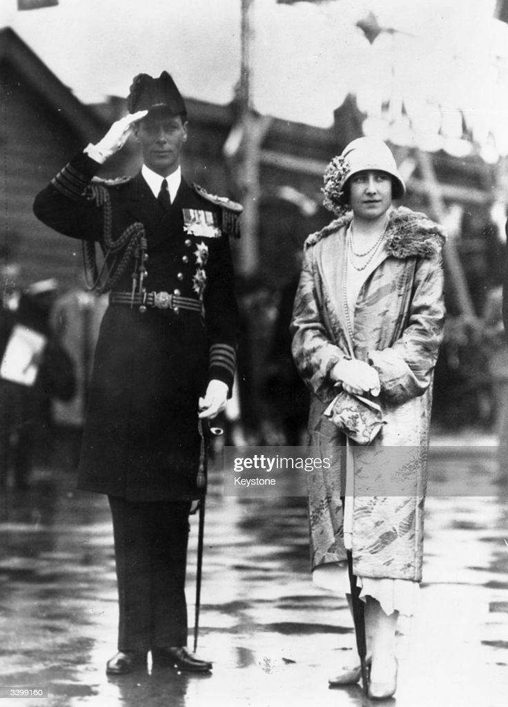 King George VI (1895 - 1952) wearing a Royal Navy Admiral's uniform with his wife, Queen Elizabeth (1900 - 2002).